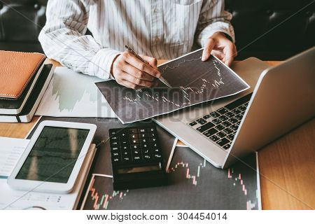 Investment Stock Market Entrepreneur Business Man Discussing And Analysis Graph Stock Market Trading