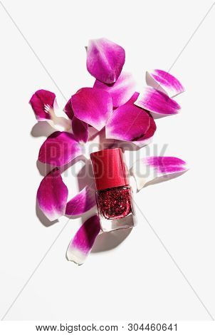 Nail Polish Of Beautiful Red Colors On White Background.