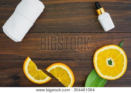 White Vitamin C Bottle And Oil Made From Orange Fruit Extract, Mockup Of Beauty Product Brand. Top V