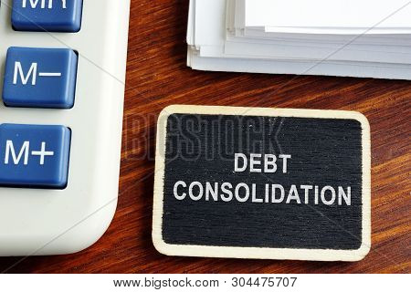 Debt Consolidation Loan. Nameplate With Stack Of Documents.