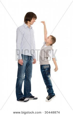 Younger brother of measuring the growth of an older brother.