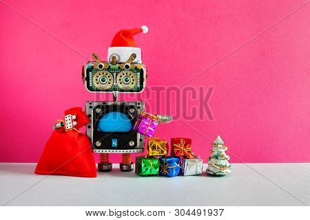 Celebration Christmas Party New Year Santa Claus Robotic Greeting Card. Happy Robot In Santa Hat, Re