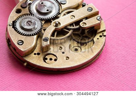 Retro Pocket Watch Mechanic Clockwork Mechanism, Spring Bronze Cogs Wheels Macro View. Shallow Depth