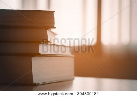Book In Library.book Stack On Wood Desk.ducation Background, Back To School Concept.