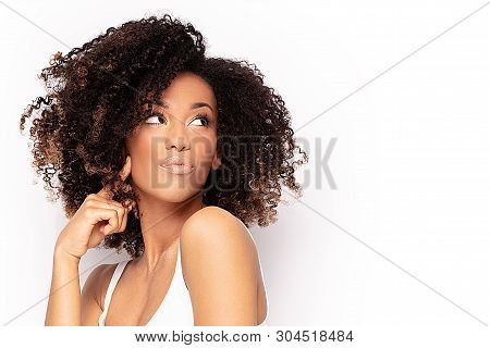 Young Afro Girl Posing In Studio.