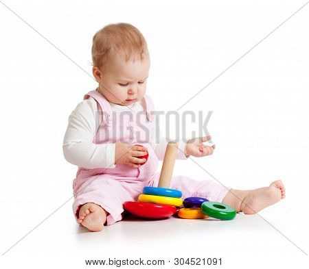 Adorable Baby Playing Enthusiastically Woth Educational Toy. Small Kid Sits On Floor, Isolated On Wh