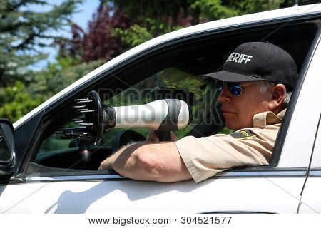 Police Radar Trap. A man pretends to be a radar police man while he uses a hair dryer as a radar gun. Hair Dryers and Radar Guns can Almost look alike but have very different uses.