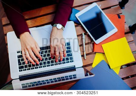 Woman Working On Laptop At Cafe.female Hands Typing On Keyboard.modern Notebook, Tablet, Notebook On