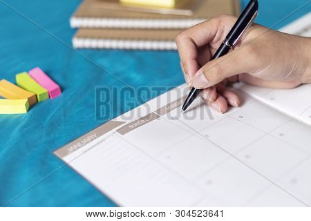 Woman Planning Agenda And Schedule Using Calendar Event Planner, Writing Plan On Memo Scheduled, Pla