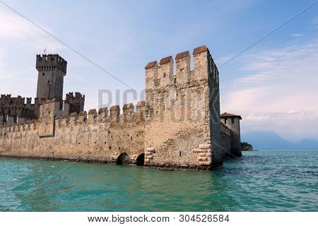 Scaliger Castle in Sirmione, ancient Castle in the Historical town Sirmione on peninsula in Garda lake, Lombardy, Italy