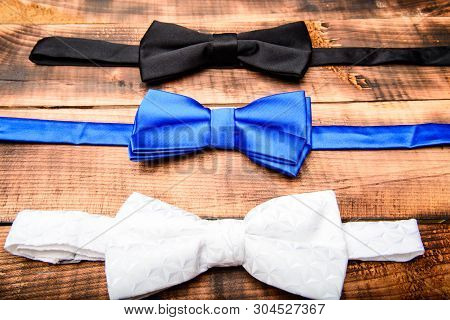 poster of Esthete detail. Fix bow tie. Groom wedding. Textile fabric bow close up. Modern formal style. Menswear clothes. Perfect outfit. Tying bow tie. Wedding accessories. Fashion accessory