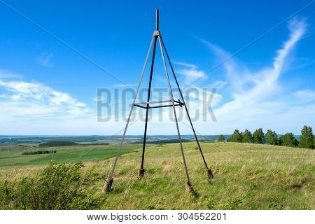 Summer Landscape. Metal Tower On Top Of A Hill. Geodesic, Triangulation Point.