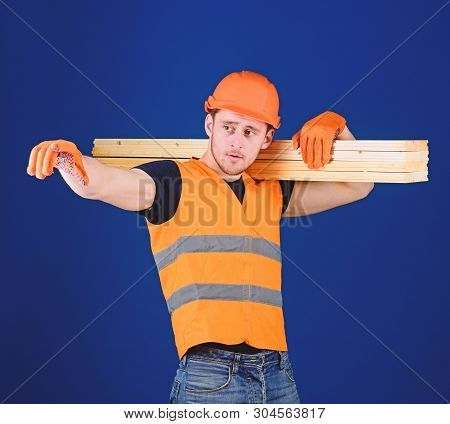 Man In Helmet, Hard Hat And Protective Gloves Pointing Direction, Blue Background. Carpenter, Woodwo