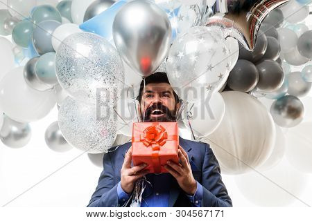 Bearded Man In Suit Holds Birthday Gift. Festive Event Or Birthday Party. People, Joy, Birthday, Cel