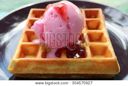 Closeup Mouthwatering Strawberry Ice Cream With Fresh Baked Waffle