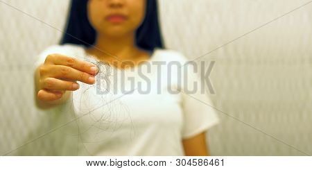Soft Focus To Young Woman With Hair Loss Problem On Hand In Toilet With Copyspace. - Alopecia Areata