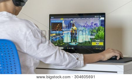 Vilnius, Lithuania - June 02, 2019: Boy Playing Fortnite. Fortnite Is Online Video Game Developed By