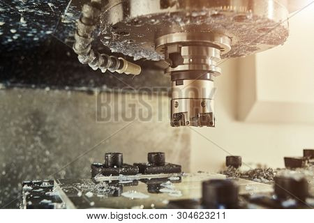 milling cnc machine at metal work industry. Multitool precision manufacturing and machining