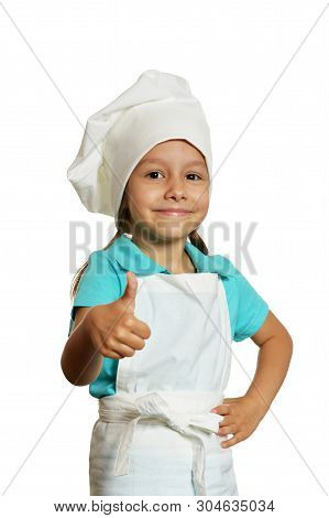 Portrait Of Little Girl Wearing Chef Uniform Isolated On White Background