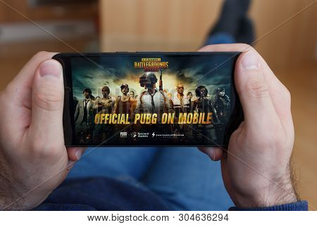 Los Angeles, California - June 3, 2019: Lying Man Holding A Smartphone And Playing The Playerunknown