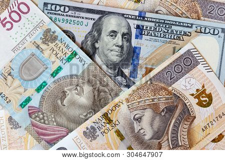 Close-up macro photography of dollar and polish zloty. Business money exchange concept background.