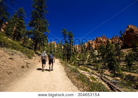 Two Unidentified Men Hiking In The Bottom Of Bryce Cannyon