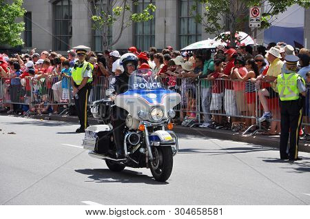 Ottawa, Canada - July 1, 2011: Rcmp Police Tasks On Motorcycle Guard On Canada Day In Ottawa, Ontari