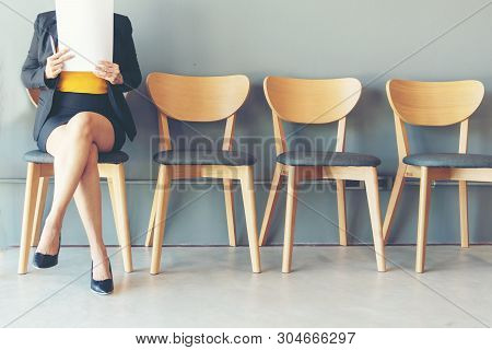Job Interview. Asian Women Review Document While Waiting For Job Interview Business Concept