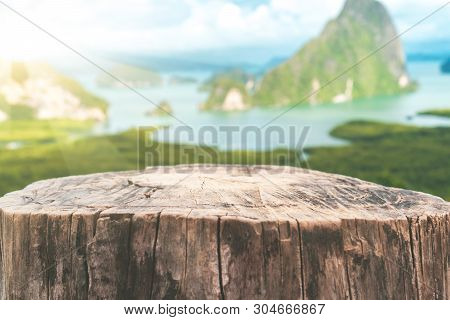 Old Empty Wood Table On Top Of Mountain View Island And Beach Abstract Background. Copy Space For Pr