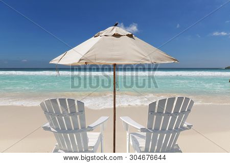 Umbrella And Chairs On Vacation Tropical Beach. Summer Vacation And Tropical Beach Concept.