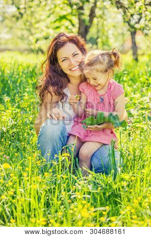 Mother and daughter in spring sunny park