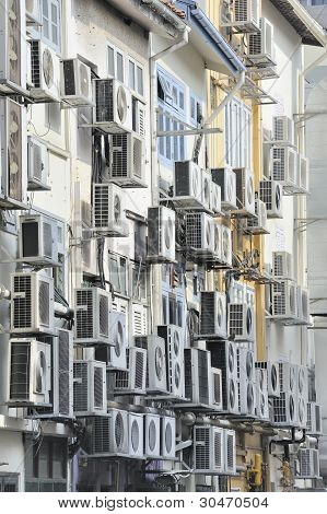 Air conditioners in busy asian city street