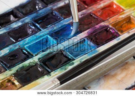 Macro. Brush And Professional Colorful Watercolor Paints Closeup
