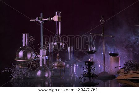 Magical Quackery Ritual. Glass Flasks, Lit A Candle And Ancient Book In A Mysterious Smoke