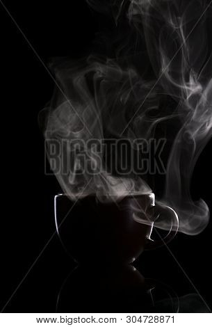 Dark Cup With Hot Coffee And Steam, Isolated On Black Background