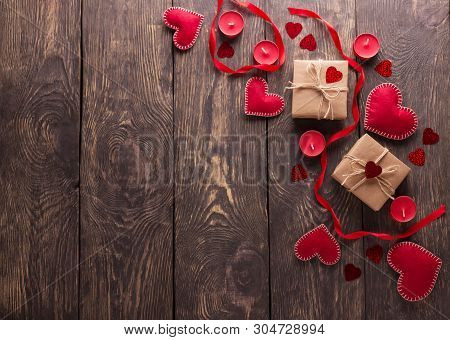 Top View. Festive Composition. Hearts From Red Felt, Boxes Handmade On A Wooden Table