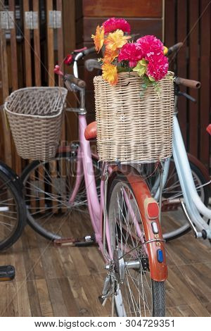 Place Decoration With A Bouquet Of Flowers In A Basket And Bicycle