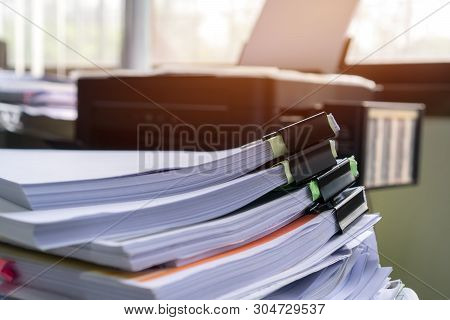 Stacks Of Piles Unfinished Papers Documents Files In Accounting Business Report With Black Clips Pap