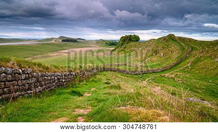 Rain Clouds over Hadrian's Wall, a UNESCO World Heritage Site in the beautiful Northumberland National Park. popular with walkers along the Hadrian's Wall Path and Pennine Way
