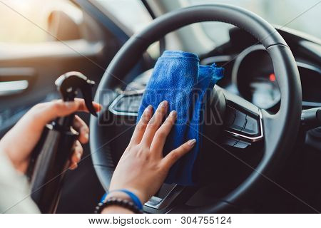 Professional Hands Of Woman Cleaning Steering Wheel And Console Car Using Microfiber Cloth Protectio