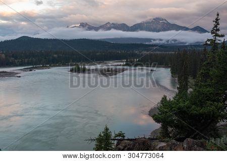 A View Of Jasper And The Athabasca River As It Weaves Its Way Through The Jasper National Park, Cana