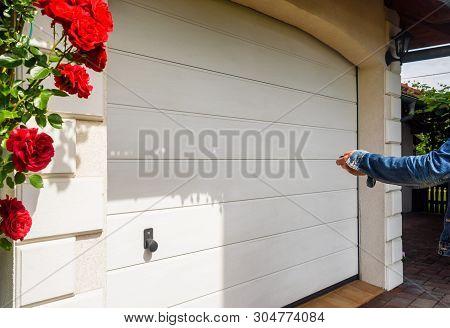 Garage Door Pvc. Hand Use Remote Controller For Closing And Opening Garage Door.