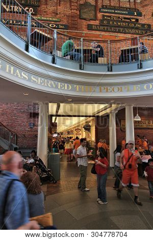 Boston, Usa - June 9, 2013: People Visit Faneuil Hall Market In Boston. Faneuil Hall Has Been A Mark