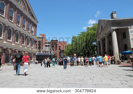 Boston, Usa - June 9, 2013: People Visit Quincy Market In Boston. Quincy Market Dates Back To 1825 A