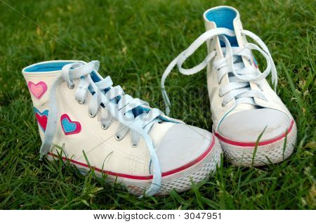 Girl Sport Shoes In The Grass