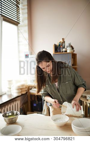Waist Up Portrait Of Contemporary Female Ceramist Working In Pottery Studio, Copy Space