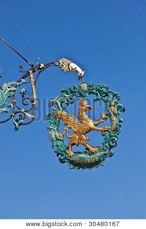 Lion And  Eagle As Sign For An Old Restaurant In Medieval Romantic Town Of Dinkelsbuehl In Bavaria,
