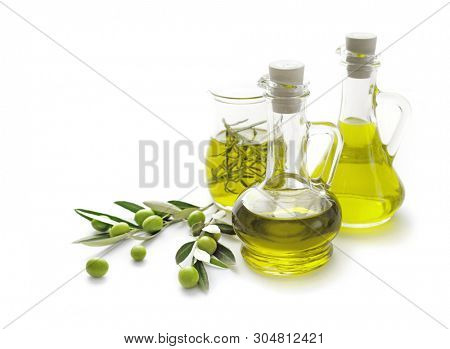 bottles of olive oil with olives isolated on white background. Olive oil in bottle, leaves and olives