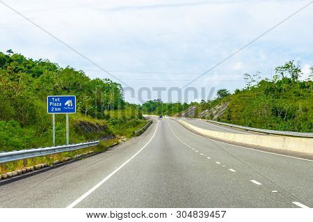 Toll Plaza Ahead Street Sign/signage On Dual Carriageway Highway Where Vehicles Drive On Left Hand S