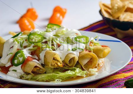 Flautas, Also Called Taquitos, Mexican Food, Chicken Rolled In Tortillas And Fried, Served With Tort